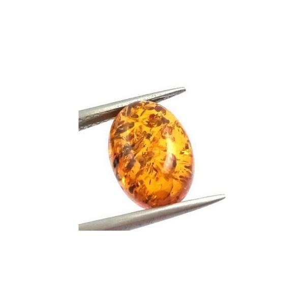 Orange oval cabochon amber